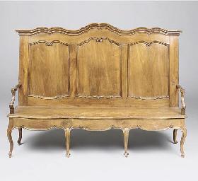 An Italian carved walnut bench