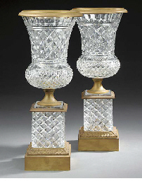 A pair of gilt bronze and hob-