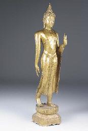 A gilt metal cast figure of a