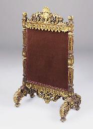 A walnut and gilt fire screen,