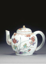 A JAPANESE MOULDED TEAPOT AND
