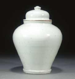 A KOREAN WHITE GLAZED JAR AND