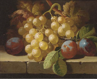 Grapes and plums on a stone le