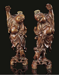 A pair of Chinese wooden carvings of Liuhai