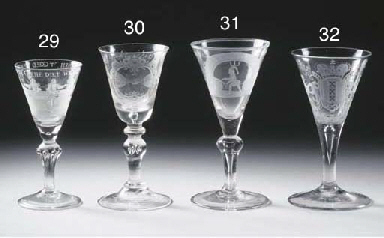 A Dutch engraved armorial wine glass and an English white opaque-twist wine...