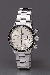 Rolex. A fine and rare stainless steel water-resistant chronograph wristwatch with exotic monochromatic silvered dial