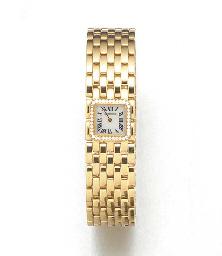 CARTIER: A LADY'S 18ct. GOLD DIAMOND SET QUARTZ WRISTWATCH signed Cartier...