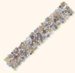 A DIAMOND AND COLORED ROUGH DI