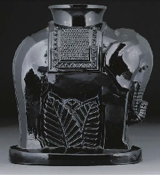 A moulded black glass vase