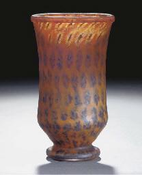 A mottled glass vase