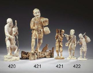 A group of eleven ivory okimon