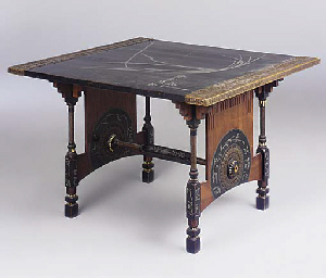 AN INLAID DINING TABLE