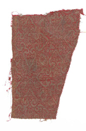 A panel of red and gold compound weave silk , woven with quatrefoil...