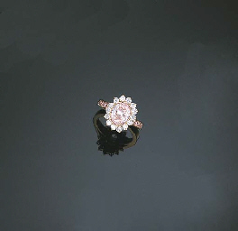 A FANCY PINK DIAMOND AND DIAMOND RING