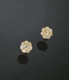 A PAIR OF YELLOW DIAMOND EARRI
