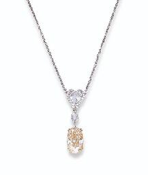 A FANCY LIGHT PINK DIAMOND AND