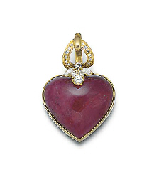 A heart shaped cabochon ruby a