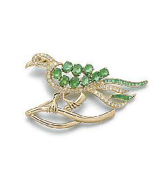 A diamond and gem bird on a bo