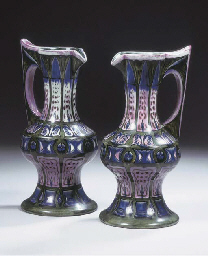 A pair of glazed pottery pitch