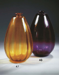 A large amber glass vase