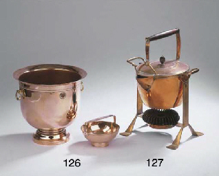 A copper kettle and stand