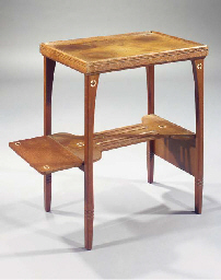 An inlaid oak tea table