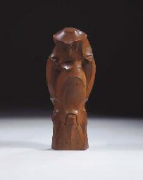 An owl, a wooden figure