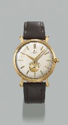 Rolex. An 18K gold self-windin