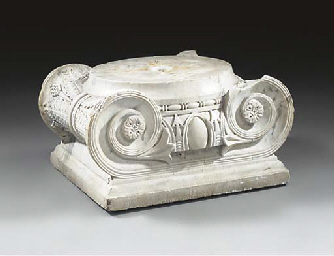 A CARVED MARBLE IONIC CAPITAL