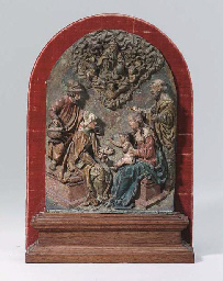 A POLYCHROME CARVED WOOD RELIE
