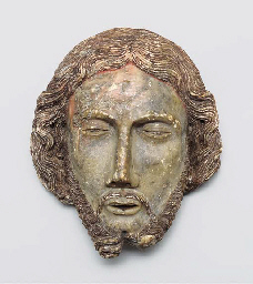 A CARVED ALABASTER HEAD OF ST.