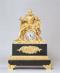 A FRENCH EMPIRE ORMOLU AND BRO