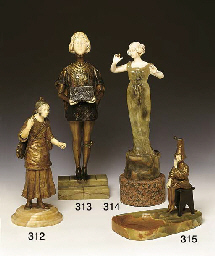 * A BRONZE AND IVORY FIGURE OF