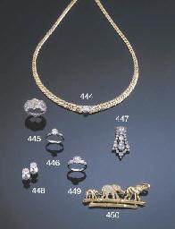 A FANCY COLOURED DIAMOND TRIPL