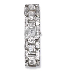 A DIAMOND BRACELET WATCH, BY C