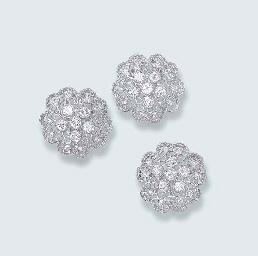 A PAIR OF DIAMOND FLORAL EARRI