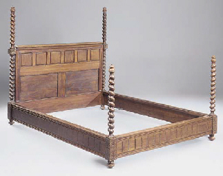 A FRENCH OAK PANELLED BED