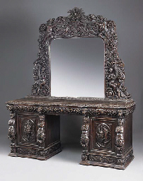 A LARGE CARVED OAK MIRROR BACK