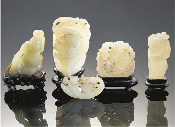 A group of five celadon jade c
