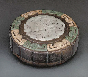 An inlaid hardwood box and cov