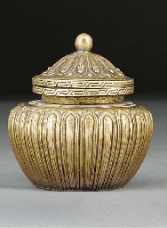 A Tibetan gilt copper jar and