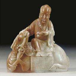 A figural carved soapstone cup