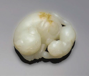 A pale celadon jade cat group,