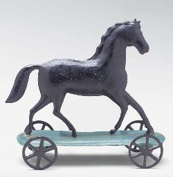 A CAST IRON TOY HORSE