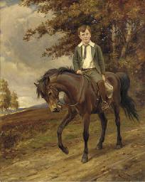 Portrait of a boy on a pony