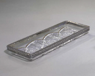 A silver-mounted glass dish