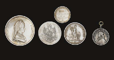 A group of five medals