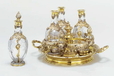 A silver-gilt four-bottle deca