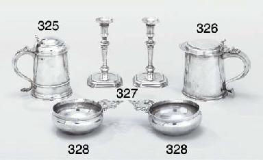 A pair of Queen Anne silver bl