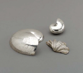 A SILVER COATED HELMET SHELL O